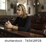 woman praying in the church | Shutterstock . vector #765618928