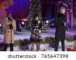 Small photo of New York, NY - November 29, 2017: Singers Matt Sallee, Kirstin Moldanado, Scott Hoying of group Pentatonix performs during the 85th Rockefeller Center Christmas Tree Lighting at Rockefeller Center