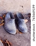 Small photo of Dirty old boots and goloshes