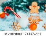 christmas gingerbread and milk...   Shutterstock . vector #765671449