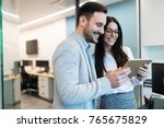 attractive business couple... | Shutterstock . vector #765675829