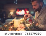 bearded man decorating... | Shutterstock . vector #765679390