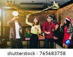 asian young people enjoy... | Shutterstock . vector #765683758