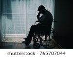 silhouette of handicapped man... | Shutterstock . vector #765707044