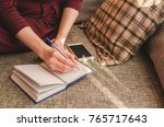 close up of lady's hand writing ... | Shutterstock . vector #765717643