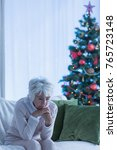 Small photo of Lonely christmas time of a female senior citizen