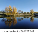 colorful autumn on calm river... | Shutterstock . vector #765732244