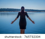 beautiful woman back looking at ... | Shutterstock . vector #765732334
