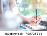 business woman hand writing on... | Shutterstock . vector #765735883