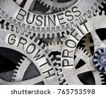 Small photo of Macro photo of tooth wheel mechanism with GROWTH, BUSINESS, PROFIT words imprinted on metal surface
