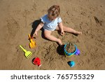toddler girl playing in the... | Shutterstock . vector #765755329