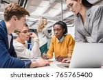 group of serious business... | Shutterstock . vector #765765400