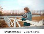beautiful woman using phone... | Shutterstock . vector #765767548