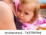 young girl at the beach covered ... | Shutterstock . vector #765789346