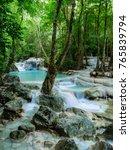 deep forest waterfall in... | Shutterstock . vector #765839794