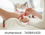 woman feet receiving pedicure.... | Shutterstock . vector #765841420
