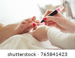 woman feet receiving pedicure.... | Shutterstock . vector #765841423