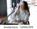 young beautiful woman making... | Shutterstock . vector #765841999