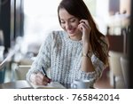 young beautiful woman making... | Shutterstock . vector #765842014