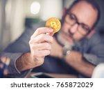 bitcoins   bitcoin in hand of a ... | Shutterstock . vector #765872029