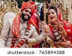indian bride and groom dressed... | Shutterstock . vector #765894388