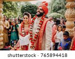 indian groom dressed in white... | Shutterstock . vector #765894418