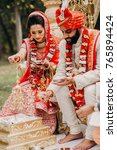 indian bride and groom dressed... | Shutterstock . vector #765894424