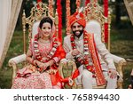 indian bride and groom dressed... | Shutterstock . vector #765894430