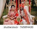 indian bride and groom dressed... | Shutterstock . vector #765894430