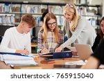 female teacher working with... | Shutterstock . vector #765915040