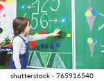 first grade boy at school ... | Shutterstock . vector #765916540