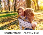 portrait of two little girls... | Shutterstock . vector #765917110
