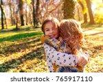 portrait of two little girls... | Shutterstock . vector #765917110