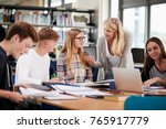 female teacher working with... | Shutterstock . vector #765917779