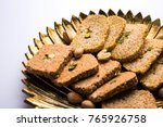 gajak or til papdi or patti is...   Shutterstock . vector #765926758