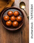 gulab jamun is a milk solid... | Shutterstock . vector #765931864