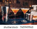 two fresh alcoholic cocktails... | Shutterstock . vector #765949963