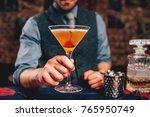 bartender serving manhattan... | Shutterstock . vector #765950749