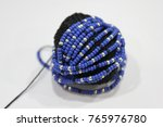 beads on the white background.... | Shutterstock . vector #765976780