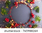 frame with christmas wreath on... | Shutterstock . vector #765988264