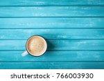 Coffee Cup On Turquoise Wooden...