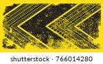 grunge tire track silhouette... | Shutterstock .eps vector #766014280