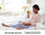 pregnancy  people and eating... | Shutterstock . vector #766025020