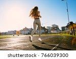 full body of girl running track ...   Shutterstock . vector #766039300
