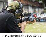 man shooting on an outdoor...   Shutterstock . vector #766061470