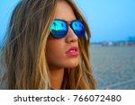 blond teen girl sunglasses at... | Shutterstock . vector #766072480