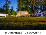Small Caravan On A Campsite At...
