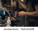 barista making latte in coffee... | Shutterstock . vector #766131658