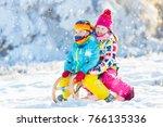 little girl and boy enjoying... | Shutterstock . vector #766135336