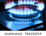gas fire of a stove in a dark | Shutterstock . vector #766136314